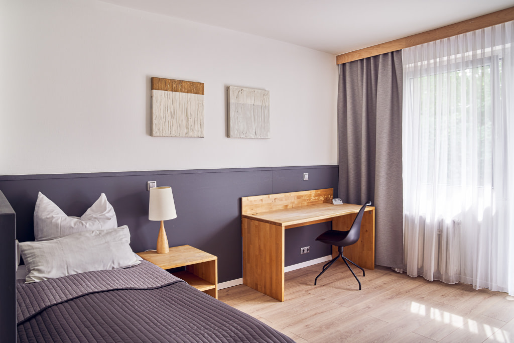Student room at the Berlin Coding Campus with single bed.