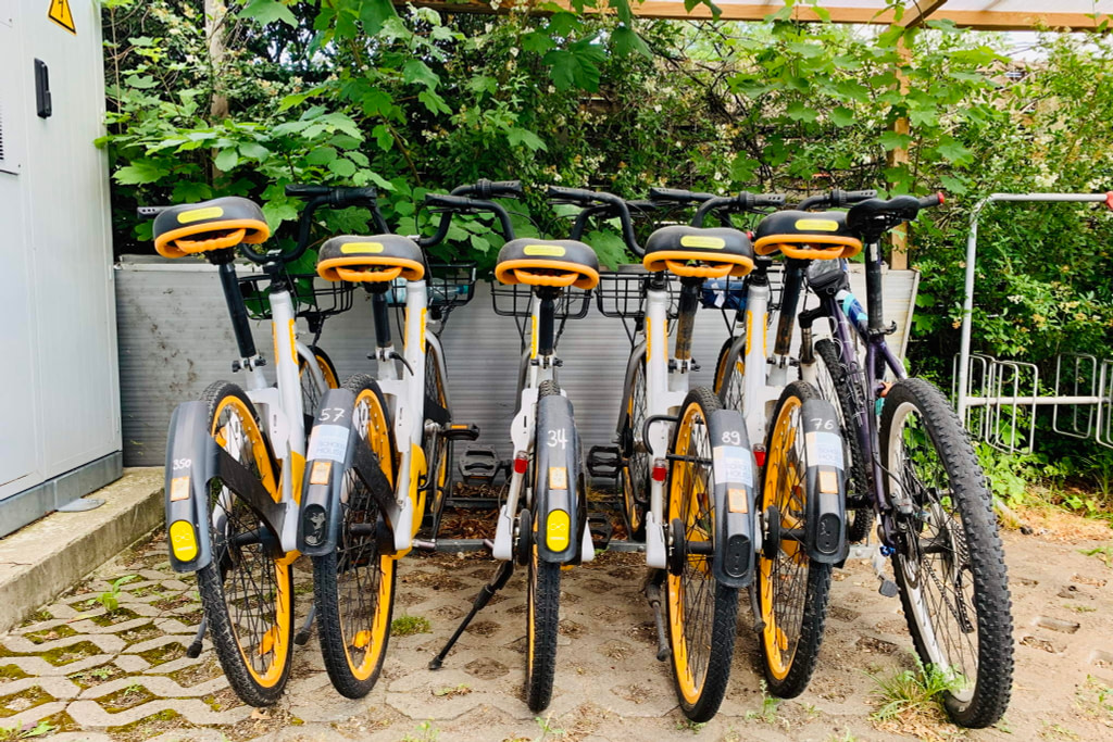 Six bikes in a cycle stand at WBS Coding Campus Berlin.