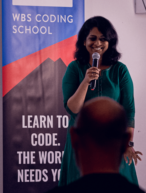 female graduate during her presentation on Demo Day for WBS CODING SCHOOL