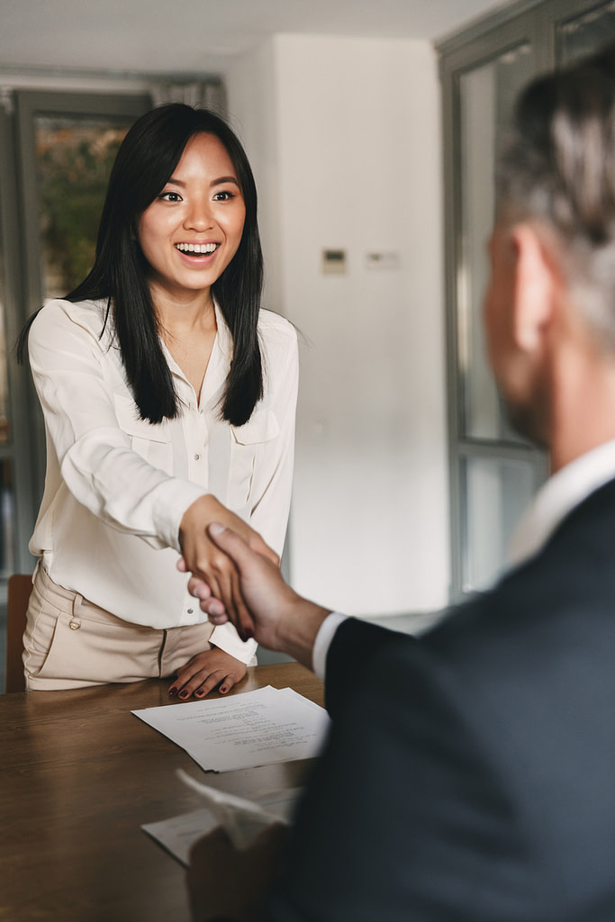 A happy woman at a successful interview