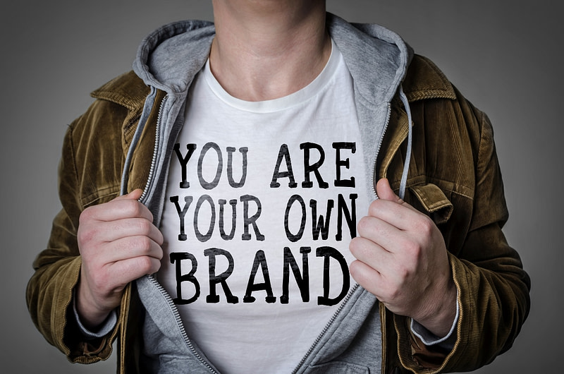 Man showing 'You Are Your Own Brand' title on his t-shirt.