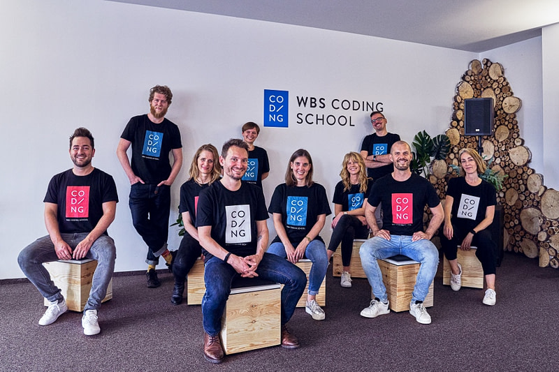 Ten team members of WBS CODING SCHOOL in the classroom at Berlin Campus